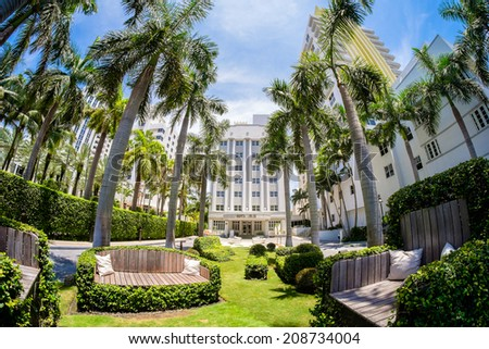 Miami Beach, Florida USA - August 1, 2014: The beautiful Royal Palm Hotel in Miami Beach, a popular international travel destination, fish eye view with palm trees and art deco architecture.