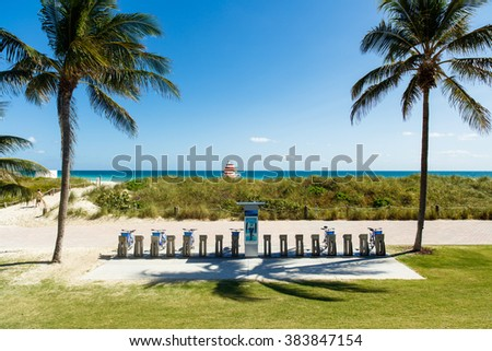 Miami Beach, Florida USA - February 25, 2016: Beautiful clear blue sky day in scenic and popular Miami Beach with Citibike rentals along the promenade. - stock photo
