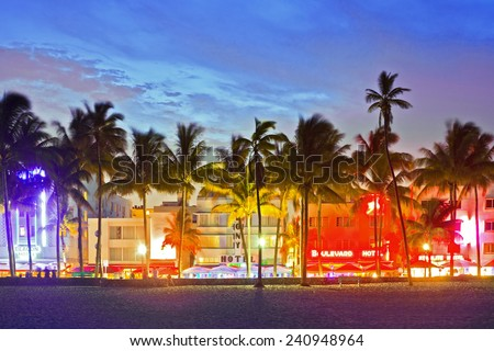 MIAMI BEACH, FLORIDA, USA-JUNE,13: Illuminated hotels and restaurants at sunset on Ocean Drive on June 13, 2013, world famous destination for nightlife, beautiful weather and pristine beaches  - stock photo