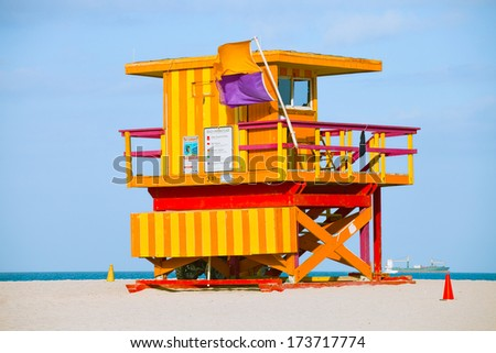Miami Beach Florida, yellow Art deco lifeguard house on a beautiful summer day with ocean in the background - stock photo