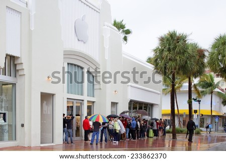 MIAMI BEACH - NOVEMBER 23: People waiting in line at the Apple Store at Lincoln Road Miami Beach on November 23, 2014 in Miami Beach USA. Apple is the worlds leading personal computer developer.  - stock photo