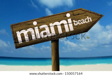 Miami Beach, United States wooden sign with a beach on background - stock photo