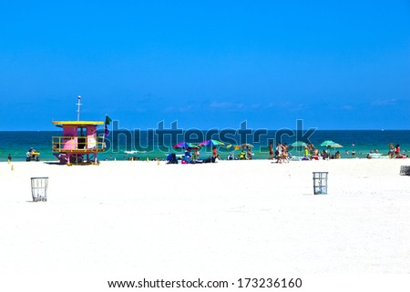 MIAMI BEACH, USA - JULY 27: People enjoy swimming in South Beach on July 27,2010 in Miami Beach, USA. In 1870, Henry and Charles Lum purchased the area and his daughter Taylor named it South Beach. - stock photo