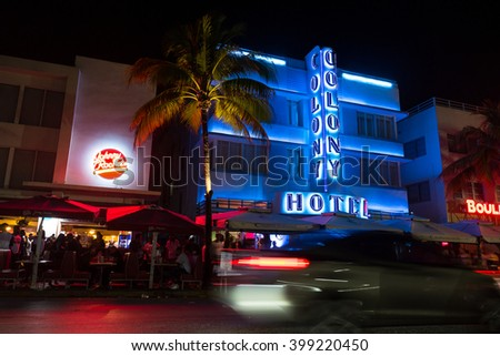 MIAMI BEACH, USA - MARCH 14, 2016: View of the famous Art Deco Colony Hotel in Ocean Drive at night. South Beach (also known as SoBe), is one of the more popular areas of Miami Beach. - stock photo
