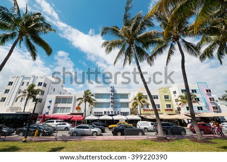 MIAMI BEACH, USA - MARCH 14, 2016: View of the famous Art Deco Colony Hotel in Ocean Drive. South Beach (also known as SoBe), is one of the more popular areas of Miami Beach.  - stock photo