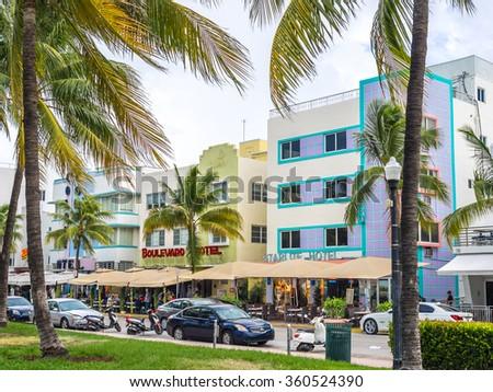 MIAMI BEACH, USA - SEPTEMBER 8, 2015. Art Deco hotels in the touristic avenue Ocean Drive, Miami Beach, Florida. - stock photo