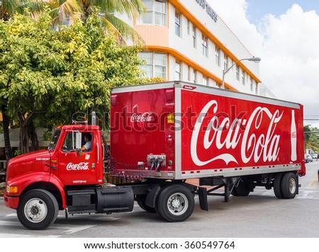 MIAMI BEACH, USA - SEPTEMBER 8, 2015. Coca Cola truck in the Art Deco district in the touristic Ocean Drive, Miami Beach, Florida. - stock photo
