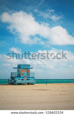 Miami Blue Lifeguard tower and coastline with colorful cloud