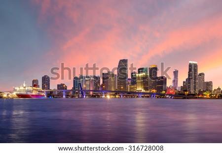 Miami city skyline panorama at twilight with urban skyscrapers and bridge USA - stock photo