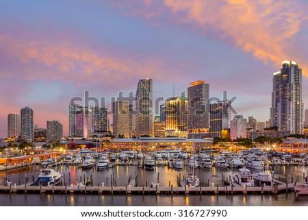 Miami city skyline panorama at twilight with urban skyscrapers, marina and bridge USA - stock photo