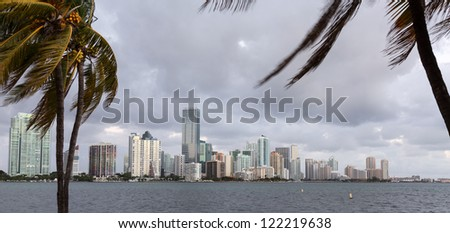 Miami cityscape skyline at dawn sunrise from Rickenbacker causeway on cloudy morning - stock photo
