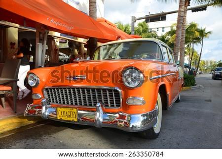 MIAMI - DEC 24: 1955 Chevrolet Bel Air in front of Edison Hotel in Miami Beach on December 24th, 2012 in Miami, Florida, USA. - stock photo