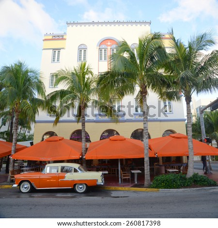MIAMI - DEC 25: Edison Building with Art Deco Style and antique Chevrolet Bel Air in Miami Beach in the morning on December 25th, 2012 in Miami, Florida, USA. - stock photo