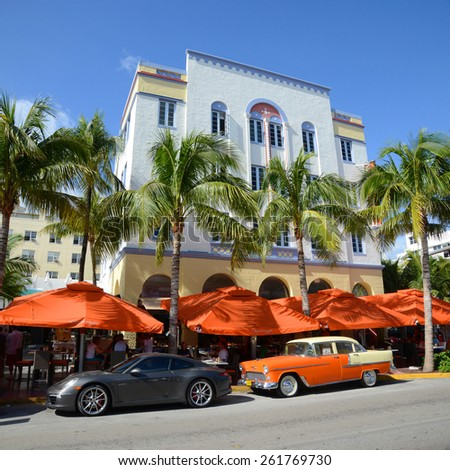 MIAMI - DEC 24: Edison Building with Art Deco Style and antique Chevrolet Bel Air in Miami Beach in the morning on December 24th, 2012 in Miami, Florida, USA. - stock photo