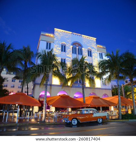 MIAMI - DEC 25: Edison Hotel with Art Deco Style Building and antique Chevrolet Bel Air in Miami Beach at night on December 25th, 2012 in Miami, Florida, USA. - stock photo