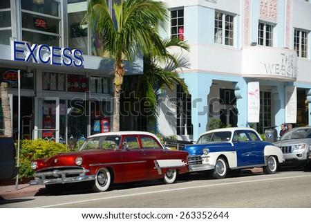 MIAMI - DEC 24: 1952 Ford Customline in Miami Beach in front of Art Deco style Excess Building in Miami Beach on December 24th, 2012 in Miami, Florida, USA. - stock photo
