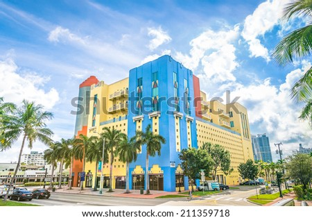 MIAMI - DECEMBER 2, 2013: art deco buildings at the crossroad of Washington Avenue with 5th Street, in South Beach Miami. The world famous China Grill moved from this building to Brickell in 2012. - stock photo