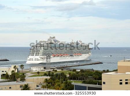 MIAMI - DECEMBER 21, 2014: Regal Princess, a Princess Cruises ocean liner, departs from Miami on a weeklong Christmas cruise  - stock photo