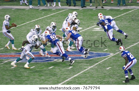 Miami Dolphins Defense protecting the quarterback against Buffalo Bills at Ralph Wilson Stadium, December 9, 2007