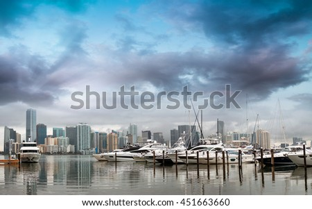 Miami Downtown at sunset with anchored boats. - stock photo
