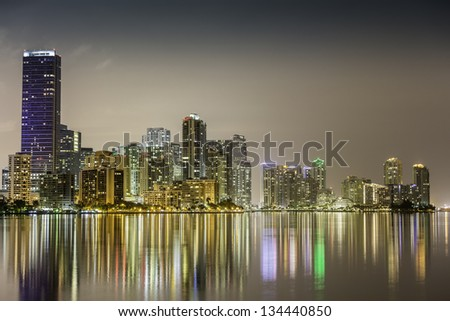 Miami downtown by night illuminated by business and luxury residential buildings in Florida - stock photo