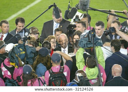 MIAMI - FEB 4: Singer Billy Joel (C) speaks with the press at Super Bowl XLI between the Indianapolis Colts and Chicago Bears at Dolphins Stadium on February 4, 2007 in Miami, Florida. - stock photo