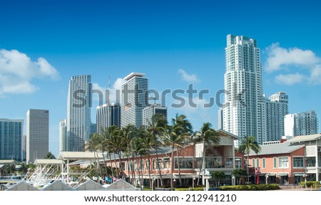 MIAMI - FEBRUARY 2, 2008: City skyline as seen from street level on a beautiful sunny day. Miami is visite by more than 10 million people every year.