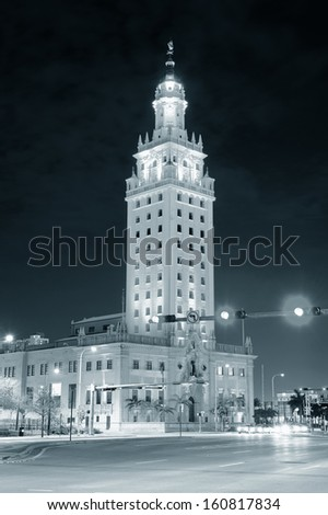 MIAMI, FL - FEB 7: Freedom Tower on street on February 7, 2012 in Miami, Florida. As a memorial to Cuban immigration and Miami city landmark, it is declared as US National Historic Landmark in 2008. - stock photo