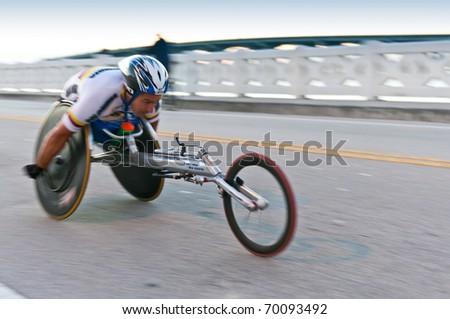 MIAMI, FL - JANUARY 30: Competitor Orlando Cortes, races in a wheekchair during the Miami Marathon. January 30, 2011 in Miami, Florida. - stock photo