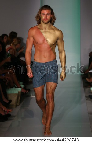 MIAMI, FL - JULY 17: A model walk runway in designers swim apparel at the Mia Marcelle fashion presentation at 1 hotel during Miami Swim Fashion Week on July 18, 2015