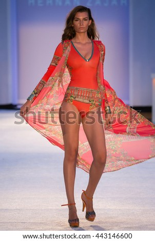 MIAMI, FL - JULY 19: A model walks runway in designer swim apparel during Hernan Zajar - Protela Colombian Brands fashion show at W hotel for Miami Swim Week on July 19, 2015