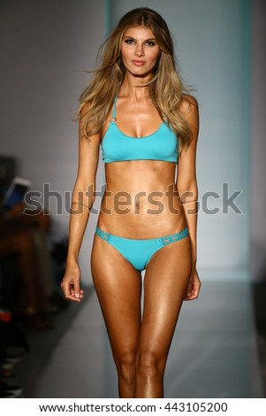 MIAMI, FL - JULY 19: A model walks runway in designers swim apparel during the Lybethras Swim fashion show on July 19, 2015 - stock photo