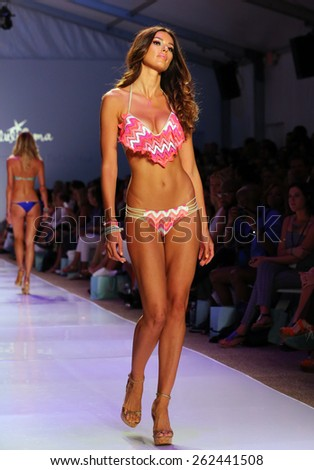 MIAMI, FL - JULY 20: A model walks the runway at the Luli Fama during MBFW Swim 2015 at The Raleigh hotel on July 20, 2014 in Miami, FL.