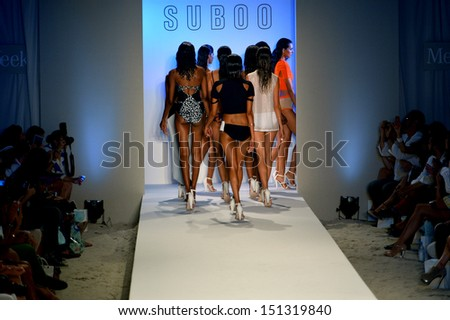 MIAMI, FL - JULY 19: Models walk the runway finale at the Suboo show during Mercedes-Benz Fashion Week Swim 2014 at Oasis at the Raleigh on July 19, 2013 in Miami, Florida. - stock photo