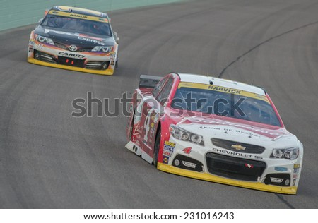 MIAMI, FL - Nov 16: Kevin Harvick at the Nascar Sprint Cup Ford Ecoboost 400 race at Homestead-Miami Raceway in Homestead, FL on November 16, 2014