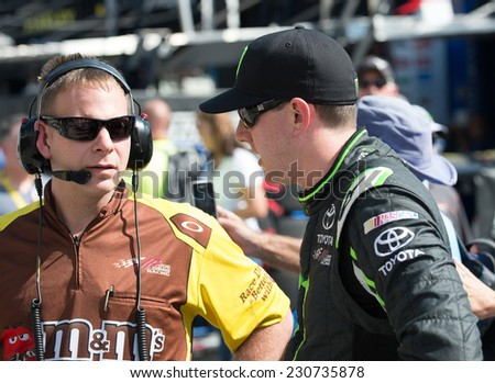 MIAMI, FL - Nov 15: Kyle Busch and crew chief Dave Rogers Nascar Sprint Cup Ford Ecoboost 400 practice at Miami Speedway in Homestead, FL on November15, 2014 - stock photo