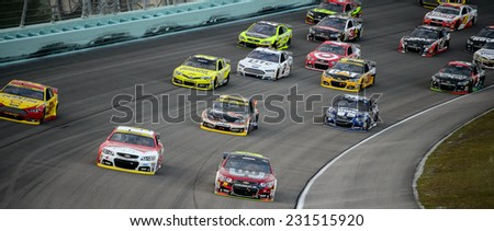 MIAMI, FL - Nov 16: Racing at the Nascar Sprint Cup Ford Ecoboost 400 race at Homestead-Miami Raceway in Homestead, FL on November 16, 2014 - stock photo