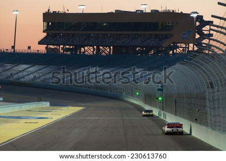 MIAMI, FL - Nov 14: Sunset at the Nascar Sprint Cup Ford Ecoboost 400 Qualifying at Miami Speedway in Homestead, FL on November 14, 2014 - stock photo