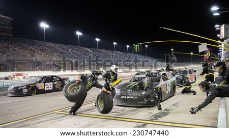 MIAMI, FL - Nov 15: Tire stop for Kyle Busch at the Nascar Nationwide Ford Ecoboost 300 race at Homestead-Miami, FL on November 15, 2014 - stock photo