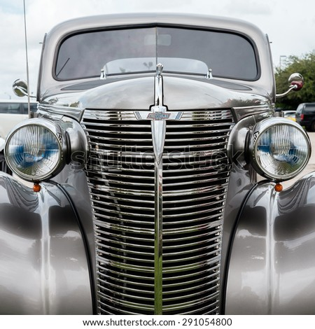 Miami, FL USA - June 14, 2015: Close up view of the front end of a beautifully restored 1938 Chevrolet model Coupe. - stock photo