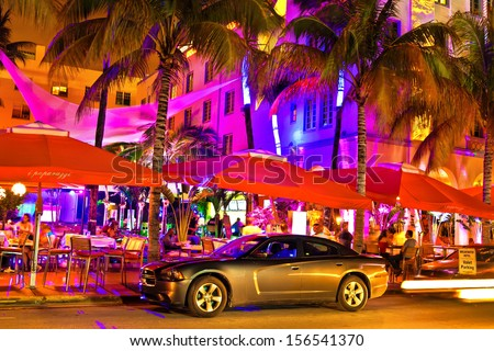 MIAMI, FL, USA, MAY 14th, 2013. Ocean Drive scene at night lights, cars and people having fun, Miami beach. La noche de Ocean Drive en Miami Beach, Florida, Estados Unidos. Taken on May 14th, 2013. - stock photo