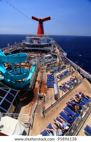 MIAMI, FLORIDA-APRIL 3: Cruise ship embarked, and people enjoyed the sunshine on the first day on April 3, 2008 in Miami, Florida. Carnival Valor is 953 feet long and has passenger capacity of 2974. - stock photo