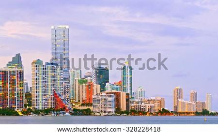Miami Florida at sunset, colorful skyline of illuminated buildings - stock photo