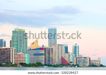 Miami Florida at sunset, colorful skyline of illuminated buildings