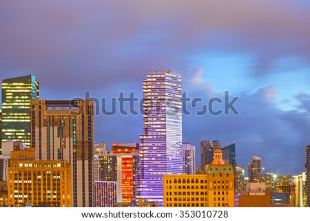 Miami Florida, illuminated downtown banks and office buildings at sunset, famous travel destination - stock photo