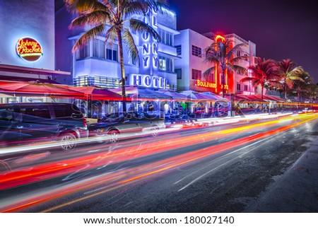 MIAMI, FLORIDA - JANUARY 6, 2014: Cars speed down Ocean Drive. The road is the main thoroughfare through South Beach. - stock photo