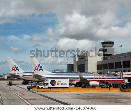 MIAMI, FLORIDA - JUNE 13: American Airlines planes at the gates on June 13, 2013 at Miami International airport.American Airlines operates 274  flights every day from Miami - stock photo