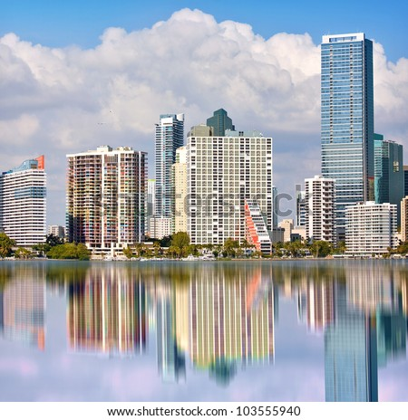 Miami Florida panorama of downtown residential and office buildings and hotels, with Biscayne bay water reflections and colorful sky on a beautiful day. Famous travel location. - stock photo