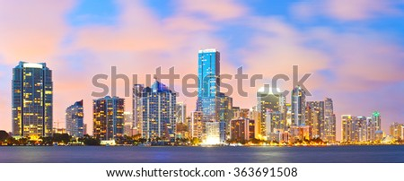 Miami Florida, sunset cityscape over the city panoramic skyline with lights on the modern downtown skyscraper buildings