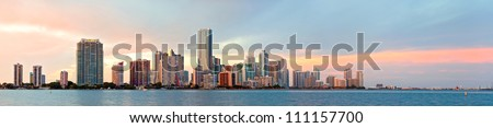 Miami Florida sunset over downtown business and luxury residential buildings, hotels and illuminated bridge over Biscayne Bay. Panoramic colorful Cityscape of World famous travel destination. - stock photo